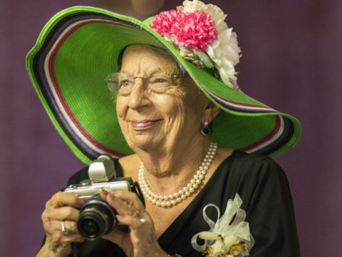Grandmother at a wedding taking pictures